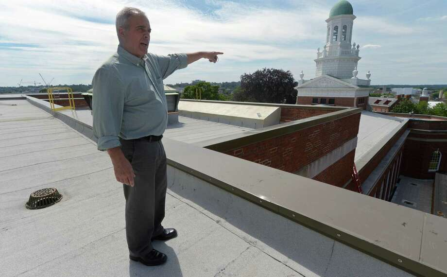 City of Norwalk Assistant Property Manager Fred Brecherton tours the newly refurbished roof at City Hall on Wednesday. A proposed rooftop solar system is off the table after officials learned the building cannot accommodate the weight. Photo: Erik Trautmann / Hearst Connecticut Media / Norwalk Hour