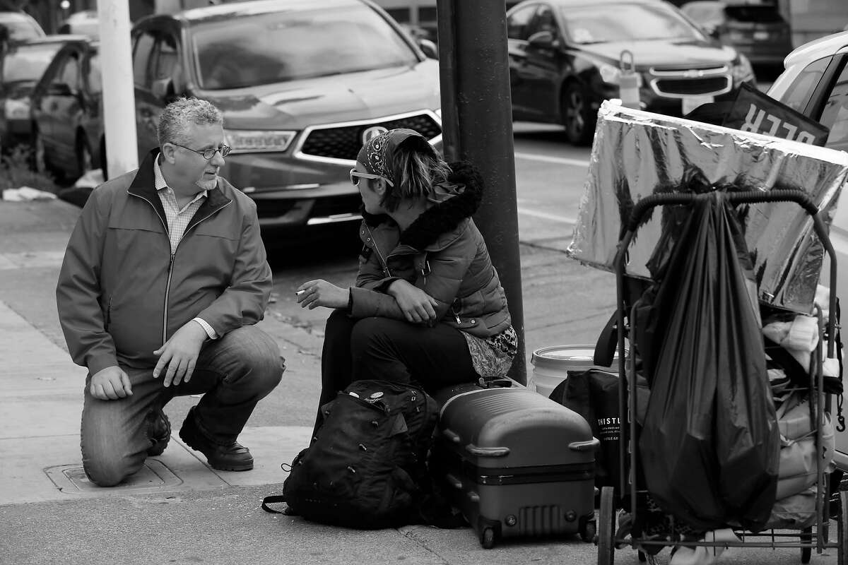 Jeff Kositsky (l to r), who leads the city�s homelessness department, talks with Angel Brown at a staging area for street counselors and doctors on Wednesday, April 25, 2018 in San Francisco, Calif.