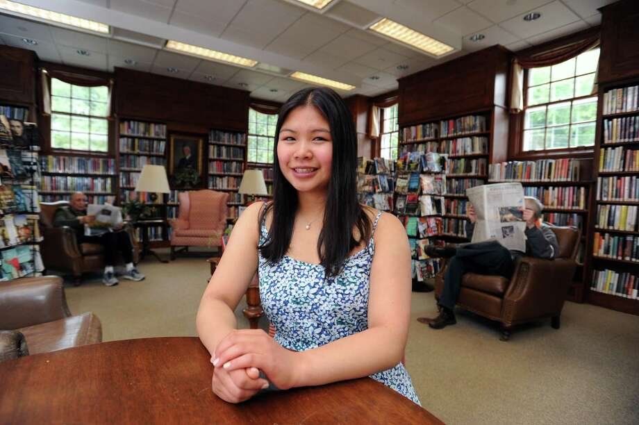 Greenwich High School senior Michelle Woo, who was named a presidential scholar, inside Perrot Library. Photo: Michael Cummo / Hearst Connecticut Media / Stamford Advocate