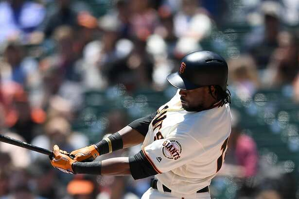 SAN FRANCISCO, CA - JUNE 20:  Alen Hanson #19 of the San Francisco Giants fouls a pitch off the top of his knee against the Miami Marlins in the bottom of the first inning at AT&T Park on June 20, 2018 in San Francisco, California.  (Photo by Thearon W. Henderson/Getty Images)