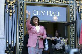 London Breed waves before speaking to reporters outside of City Hall in San Francisco, Wednesday, June 13, 2018.