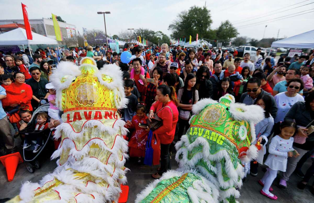 A crowd forms around the Lavang Lion Dance Team during a Lunar New Year celebration at the Chinese Community Center on Saturday, Feb. 17, 2018, in Houston.