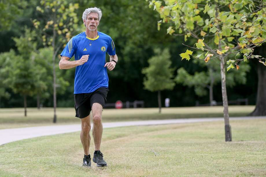 Assistant Dean of St. Mary's Law School Mike Barry out on his usual run in Olmos Basin Park in June. Just two weeks earlier, Barry completed his quest to run a marathon in under four hours in all 50 states, thus joining an elite running group known as 50sub4. Photo: Marvin Pfeiffer /San Antonio Express-News / Express-News 2018