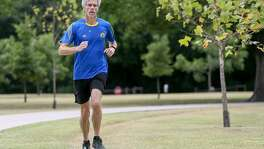 Assistant Dean of St. Mary's Law School Mike Barry out on his usual run in Olmos Basin Park in June. Just two weeks earlier, Barry completed his quest to run a marathon in under four hours in all 50 states, thus joining an elite running group known as 50sub4.