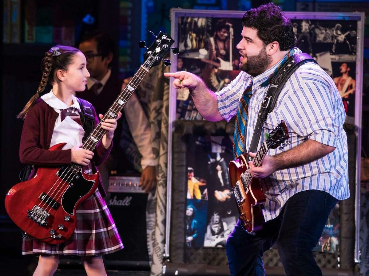 """Theodora Silverman, an 11-year-old from New York City, as bass player Katie in the national tour of """"School of Rock,"""" with Rob Colletti."""