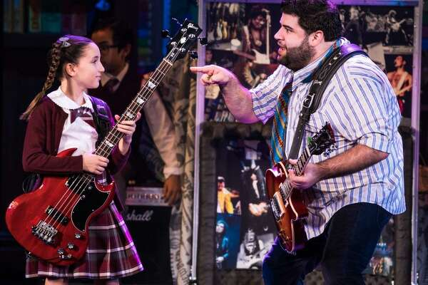 "Theodora Silverman, an 11-year-old from New York City, as bass player Katie in the national tour of ""School of Rock,"" with Rob Colletti."
