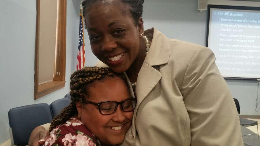 Thomas O'Brien Academy of Science & Technology5th grader Aaliyah Milgo, 10, gets a congratulatory hug from Albany City School District Superintendent Kaweeda G. Adams. (Lynda Edwards/ Times Union)