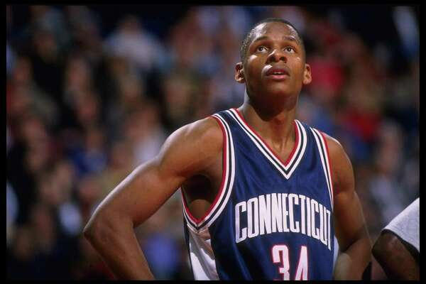 19 Feb 1996: Guard Ray Allen #34 of the Connecticut Huskies pauses on the court during a break in the action against the Georgetown Hoyas in this Big East match-up at the USAir Arena in Washington, D.C. Georgetown defeated UConn 77-65.