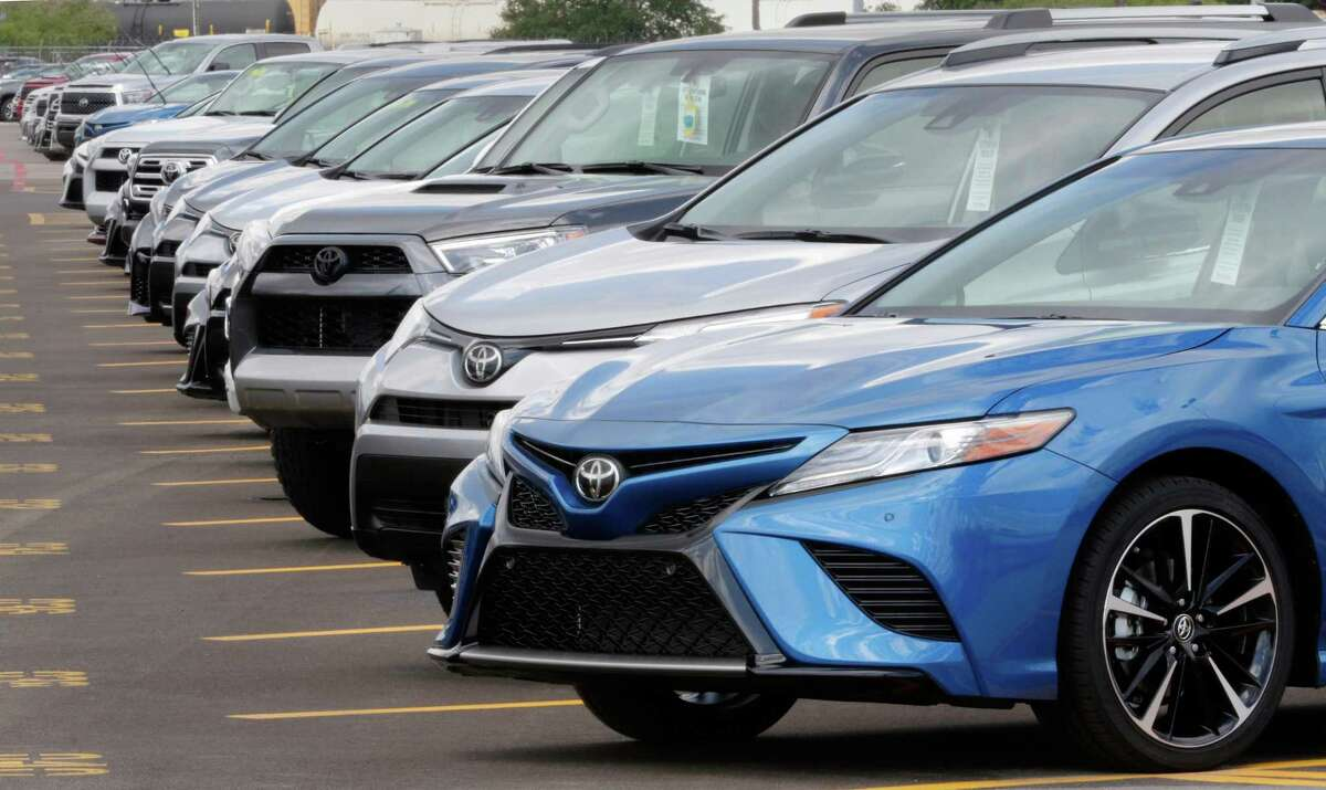 Various models of Toyota vehicles sit parked before being loaded onto car haulers, headed to dealerships at the Gulf States Toyota vehicle processing facility on May 23, 2018, in Houston.