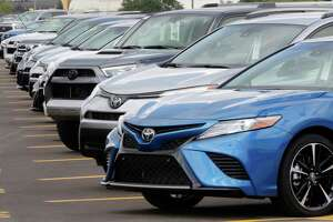 Various models of Toyota vehicles undergoing final preparations before being loaded onto car haulers (trailers, commonly known as portable parking lots) to be taken to dealerships at the Gulf States Toyota vehicle processing facility Wednesday, May 23, 2018, in Houston, TX. The facility averages around 6000 toyota vehicles on the lot at anytime being prepped and processed before being sent to Toyota dealerships. (Michael Wyke / For the  Chronicle)