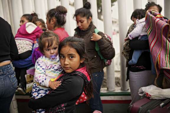 Undocumented migrants wait for asylum hearings outside the port of entry in Tijuana, Mexico on June 20, 2018.