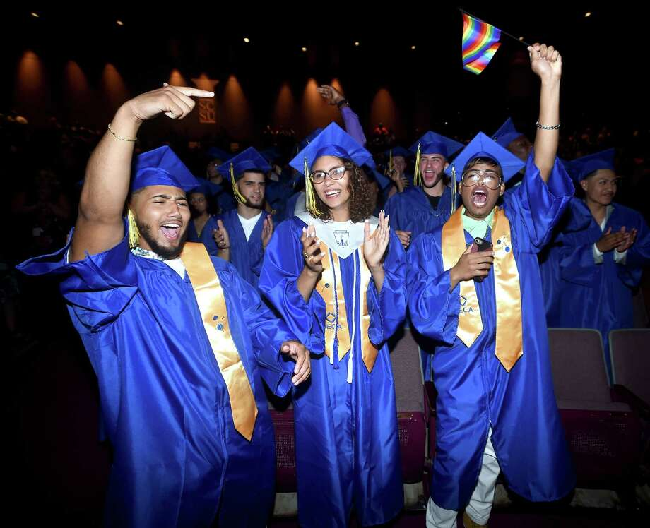 From left, Elias Donis, Ariana Huckabey and Carlos Lopez of Eli Whitney Technical High School celebrate as commencement begins at the Lyman Center of the Performing Arts at Southern Connecticut State University in New Haven on June 20, 2018. Photo: Arnold Gold, Hearst Connecticut Media / New Haven Register