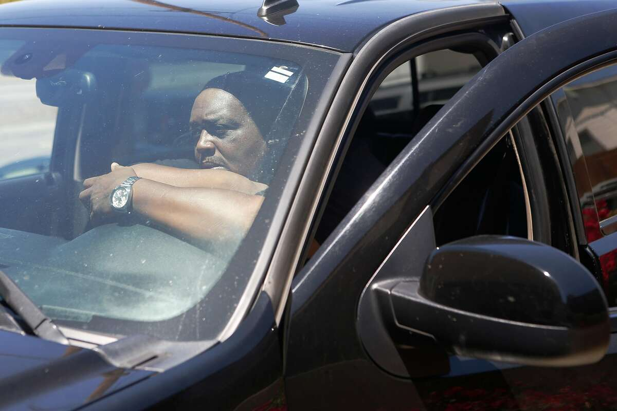Carlos Smith sits in his GMC Seiara Denali at his home on Tuesday, June 19, 2018 in San Leandro, Calif. His truck was repossessed multiple times by a fraudulent loan company that he paid $8,600 to for a $4,000 loan over the course of four years.
