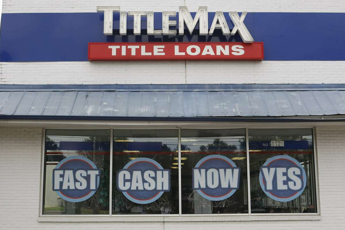 This May 31, 2016 photo shows a title loan company in Memphis, Tenn. From 2008 to 2014, for the typical or median U.S. household _ the midpoint between richest and poorest _ income fell 3 percent. For the bottom 20 percent, incomes plunged 6 percent during a time when the economy was mostly recovering. (AP Photo/Karen Pulfer Focht)