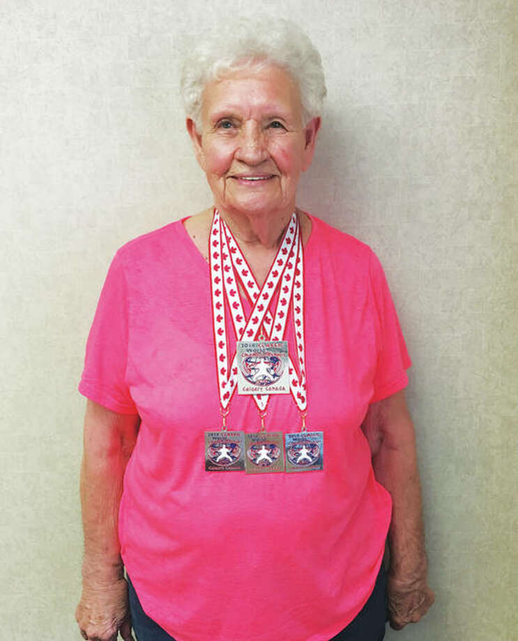 Rosewood Heights resident Shirley Webb, 80, proudly wears four silver medals she won earlier this month at the International Powerlifting Federation (IPF) RAW World Championship, in Calgary, Canada. Webb will be 81 on Aug. 12. Photo:       Jill Moon|The Telegraph