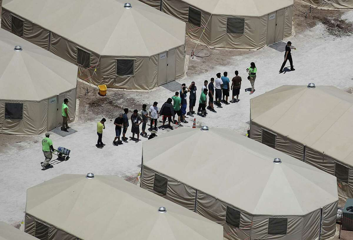Children and workers are seen at a tent encampment near the Tornillo Port of Entry on June 19, 2018 in Tornillo, Texas. The Trump administration is using the facility to house immigrant children separated from their parents after they were caught entering the United States under the administration's zero-tolerance policy.