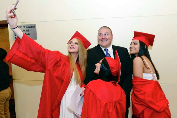 Class President Ella Nilsen takes a selfie with some of her friends and Class Advisor Robert Kucharski prior to J.M. Wright Technical High School Class of 2018 commencement ceremony at The Palace Theatre in Stamford, Conn. on June 20, 2018. This is the first graduation for the school since it reopened in August of 2014.