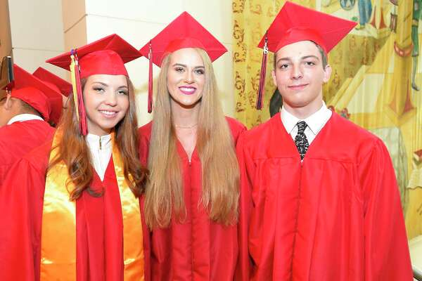 From left, Salutatorian Khrystyna Chykyta, Class President Ella Nilsen and Valedictorian Anthony Karwaski pose for a photo prior to J.M. Wright Technical High School Class of 2018 commencement ceremony at The Palace Theatre in Stamford, Conn. on June 20, 2018. This is the first graduation for the school since it reopened in August of 2014.