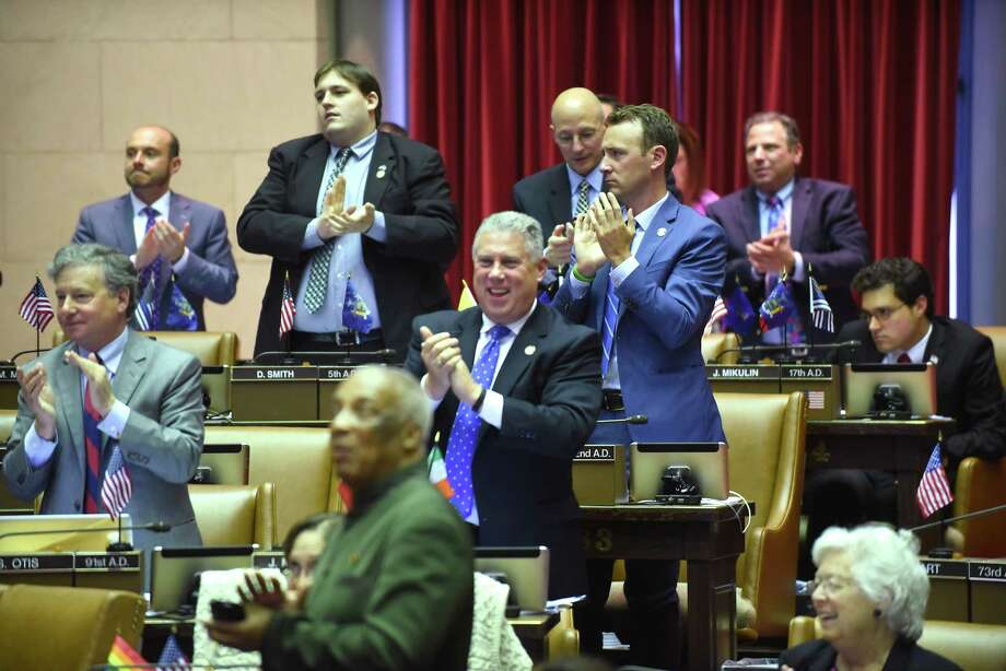 Assemblymembers applaud a bill passed in the assembly chamber on the final day of session at the Capitol Wednesday, June 20, 2018 in Albany, N.Y.(Lori Van Buren/Times Union) Photo: Lori Van Buren, Albany Times Union / 20044159A