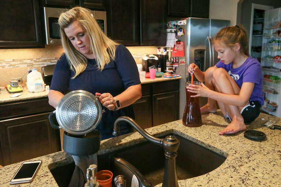 Jennifer Nolan makes a pot of macaroni and cheese while her daughter, Kenzi Nolan, 8, stirs a pitcher of tea at their home in the Sablechase subdivision in the Fair Oaks Ranch area. The family moved to Bexar County from the St. Louis area in August 2017. They wanted to settle in an area with a highly rated school district and liked that their new neighborhood was tucked away from the rush of a big city. Photo: Marvin Pfeiffer /San Antonio Express-News / Express-News 2018