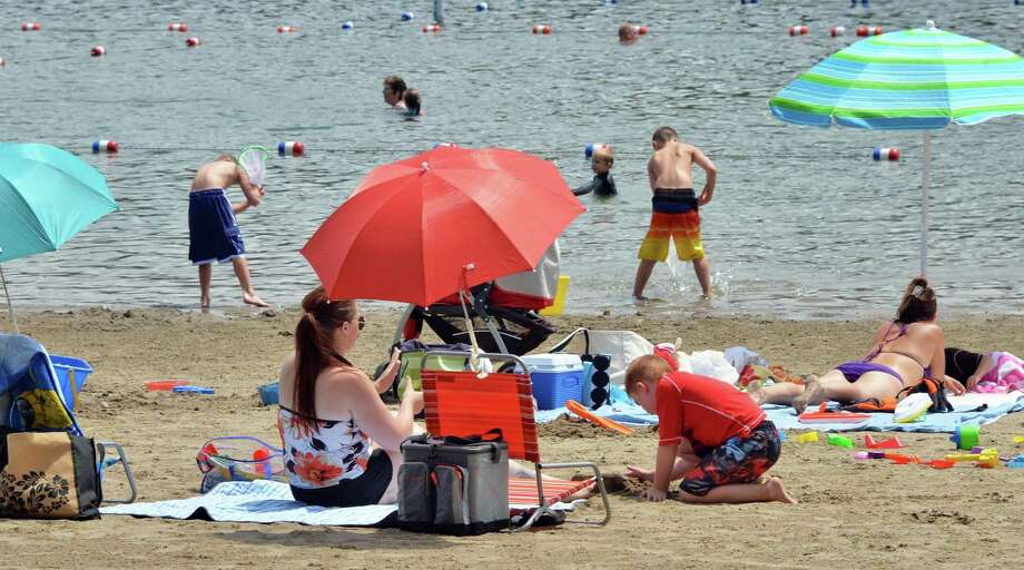 File - Beach goers at Moreau Lake State Park on Thursday, July 11, 2013, in Moreau, N.Y. The state Office of Parks, Recreation and Historic Preservation is distributing educational pamphlets about swimmer?s itch at Moreau Lake beach after two families reported skin irritations following a visit to the beach. (John Carl D'Annibale/Times Union archive) Photo: John Carl D'Annibale