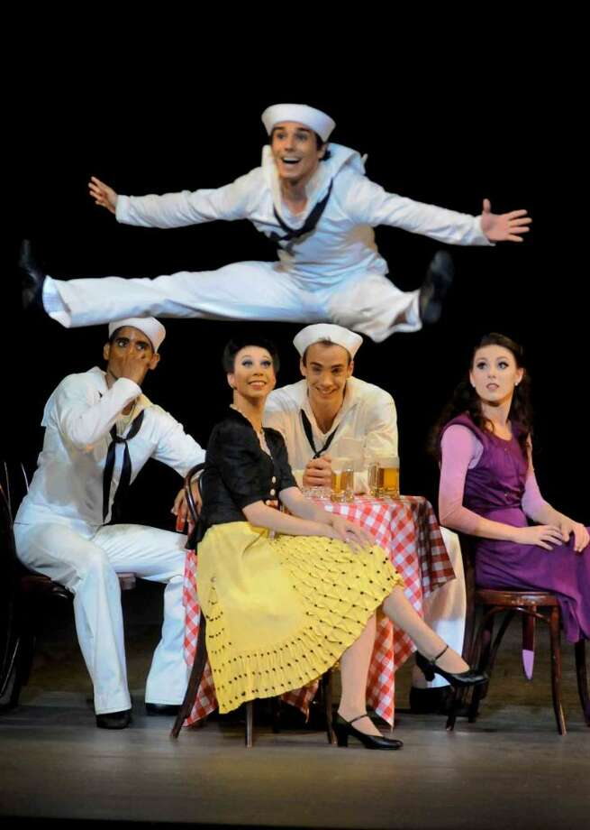 """Members of the New York City Ballet  perform """"Fancy Free"""" as part of the All American lineup for opening night at SPAC in Saratoga Spring,New York 7/06/2010. The Sailors were Tyler Angle, Joaquin De Luz and Amar Ramasar and the passers-by were Georgina Pazcoguin, Tiler Peck and Tabitha Rinko-Gay.( Michael P. Farrell / Times Union ) Photo: MICHAEL P. FARRELL"""