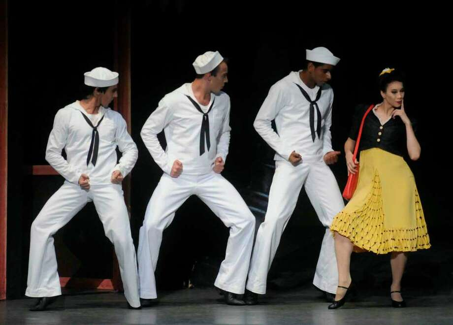 "Members of the New York City Ballet  perform ""Fancy Free"" as part of the All American lineup for opening night at SPAC in Saratoga Spring,New York 7/06/2010. The Sailors were Tyler Angle, Joaquin De Luz and Amar Ramasar and the passers-by were Georgina Pazcoguin, Tiler Peck and Tabitha Rinko-Gay.( Michael P. Farrell / Times Union ) Photo: MICHAEL P. FARRELL"