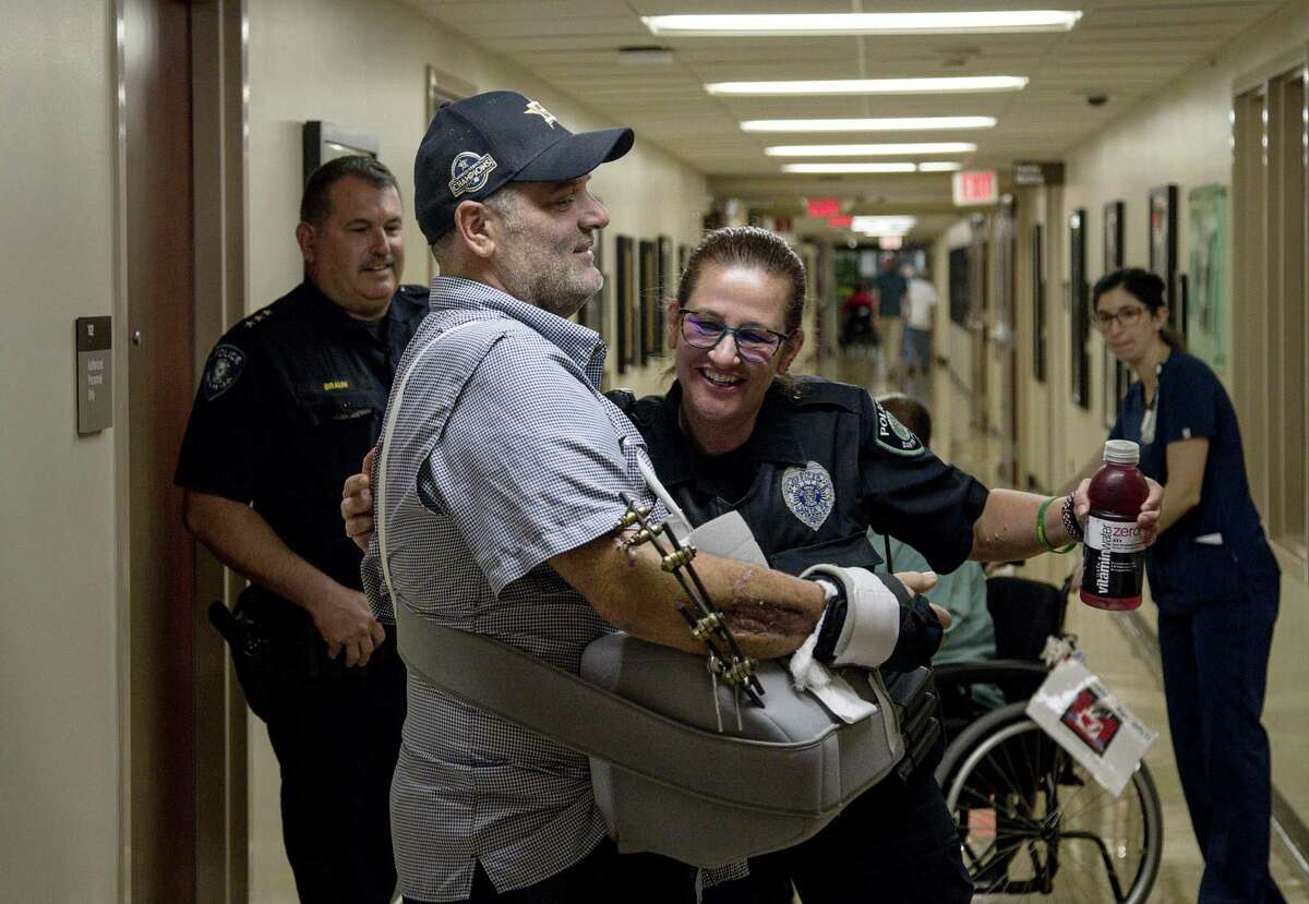 John Barnes gets a hug from Cibby Moore, a fellow Santa Fe ISD police officer, as he is released from the hospital Wednesday, June 20, 2018, more than a month after being shot in the line of duty during the May 18 shooting at Santa Fe High School.