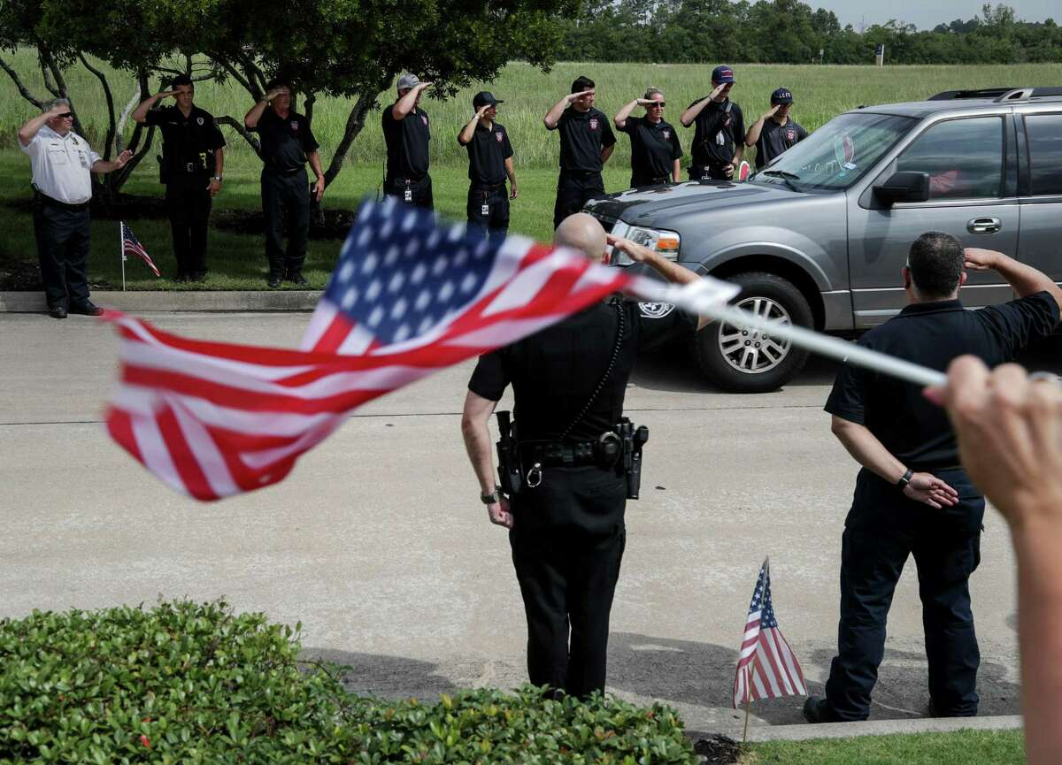 Well-wishers greet Santa Fe ISD Police Officer John Barnes as he returns to his League City home on Wednesday, June 20, 2018 after being released from the hospital more than a month after being shot May 18 in the line of duty during the Santa Fe High School shooting.