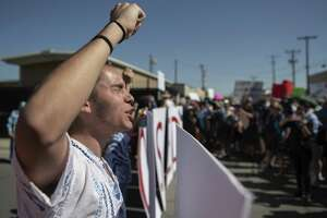 Protesters chant and block the vehicle entrance at Boder Patrol headquarters in El Paso, Texas on Tuesday June 19, 2018. The Protest, which drew several hundred marchers opposed to the separation of minors from their parents.  (Roberto E. Rosales/The Albuquerque Journal via AP)