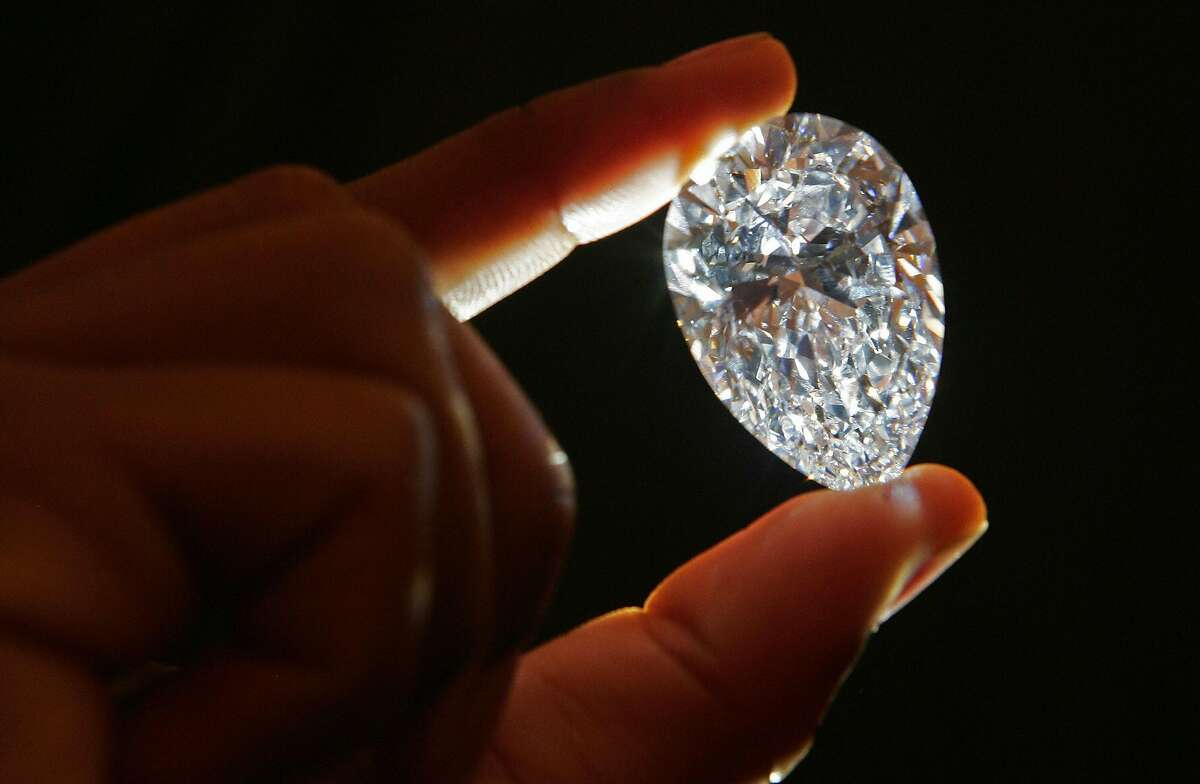 A 76.41cts flawless diamond is pictured at Graff diamond jewellers, in London, 06 December 2007. The diamond was cut from the 15th largest diamond (603ct) in the world called The 'Lesotho Promise.' The Lesotho Promise was found at the Letseng Diamond Mine in Lesotho, a kingdom surrounded by South Africa. AFP PHOTO/CARL DE SOUZA (Photo credit should read CARL DE SOUZA/AFP/Getty Images)
