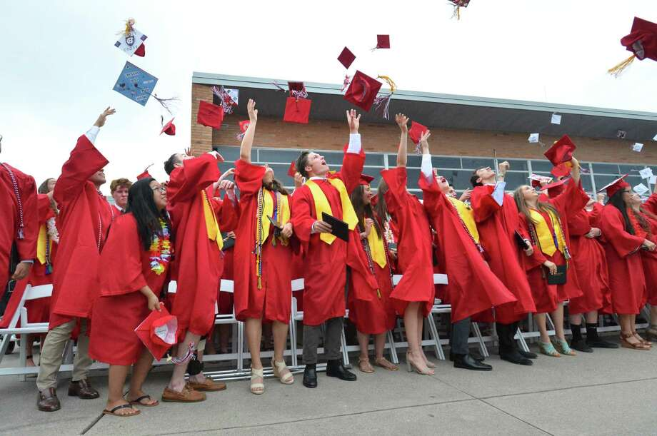 Graduates throw their caps in the air during Fairfield Warde High School Commencement Exercises on Wednesday June 20, 2018 in Fairfield Conn. Photo: Alex Von Kleydorff, Hearst Connecticut Media / Norwalk Hour