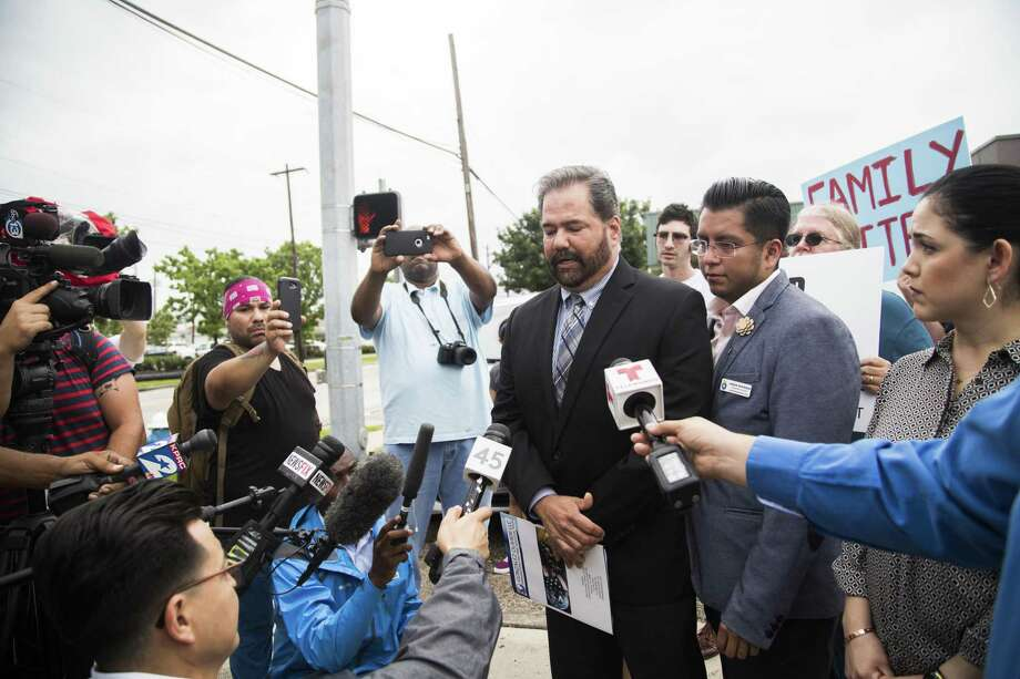 FIEL Houston director Cesar Espinosa, right, and immigration attorney Raed Gonzalez, center, lead a press conference, Wednesday, June 20, 2018, in Houston, in response to the executive order President Donald Trump signed on Wednesday meant to end separation of families. The immigration activists argue the executive order is not specific and that children would still be detained. ( Marie D. De Jesús / Houston Chronicle ) Photo: Marie D. De Jesús, Staff / Houston Chronicle / © 2018 Houston Chronicle