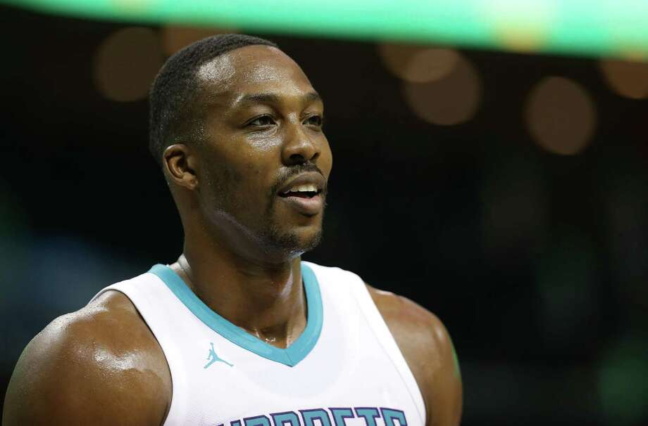 CHARLOTTE, NC - OCTOBER 13:  Dwight Howard #12 of the Charlotte Hornets watches on against the Dallas Mavericks during their game at Spectrum Center on October 13, 2017 in Charlotte, North Carolina.  NOTE TO USER: User expressly acknowledges and agrees that, by downloading and or using this photograph, User is consenting to the terms and conditions of the Getty Images License Agreement.  (Photo by Streeter Lecka/Getty Images) ORG XMIT: 775026623 Photo: Streeter Lecka / 2017 Getty Images