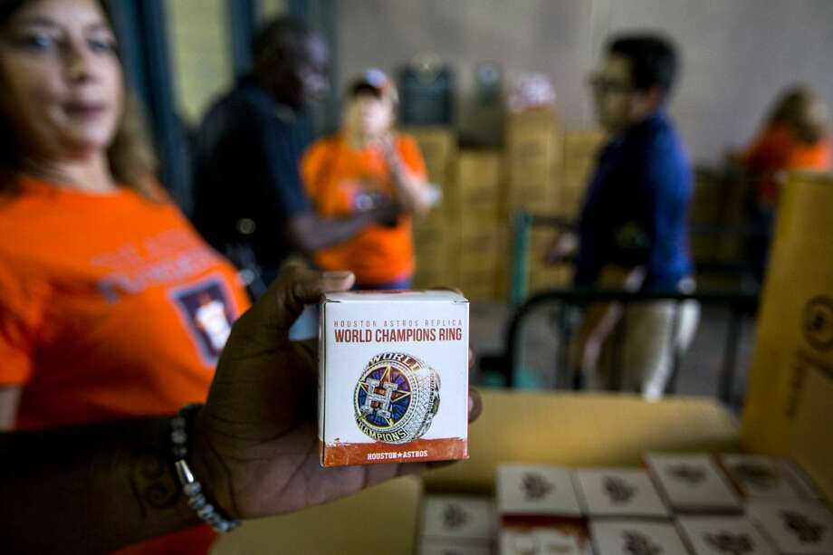 PHOTOS: Astros giveaways for fans the rest of this season Replica World Series rings are unpacked as Houston Astros fans line up outside Minute Maid Park to receive the give away before the Astros major league baseball game against the Tampa Bay Rays on Wednesday, June 20, 2018, in Houston. Browse through the photos above for a look at free stuff the Astros will give fans at games this season. Photo: Brett Coomer/Houston Chronicle