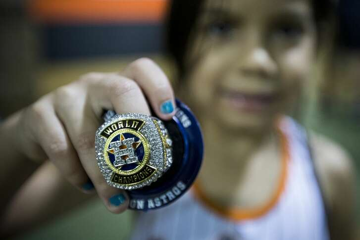 Marylin Basaldu, 5, shows off her replica World Series ring she received before the Houston Astros major league baseball game against the Tampa Bay Rays at Minute Maid Park on Wednesday, June 20, 2018, in Houston. ( Brett Coomer / Houston Chronicle )