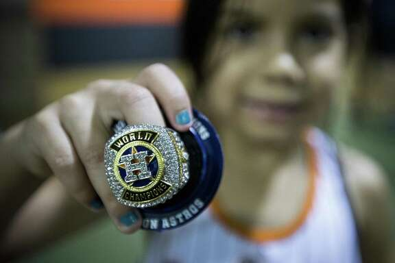 The lifetime wait of Marylin Basaldu, 5, wasn't too long, but she was no less proud of her replica ring.