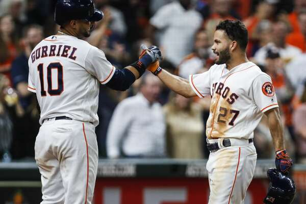 Houston Astros first baseman Yuli Gurriel (10) and second baseman Jose Altuve high five as they celebrate Altuve's solo home run off of Tampa Bay Rays starting pitcher Nathan Eovaldi during the sixth inning of a major league baseball game at Minute Maid Park on Wednesday, June 20, 2018, in Houston. It was his second home run of the game. ( Brett Coomer / Houston Chronicle )