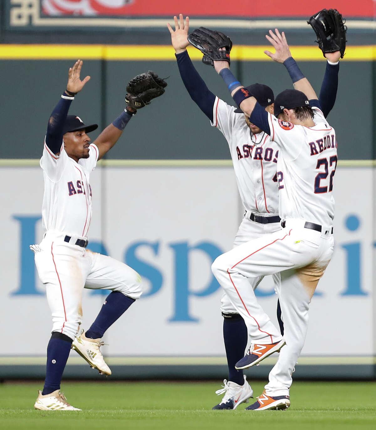 Houston Astros left fielder Tony Kemp (18), Houston Astros center fielder George Springer (4) and Houston Astros right fielder Josh Reddick (22) celebrate the Astros 5-1 win over the Tampa Bay Rays at Minute Maid Park on Wednesday, June 20, 2018, in Houston. ( Brett Coomer / Houston Chronicle )