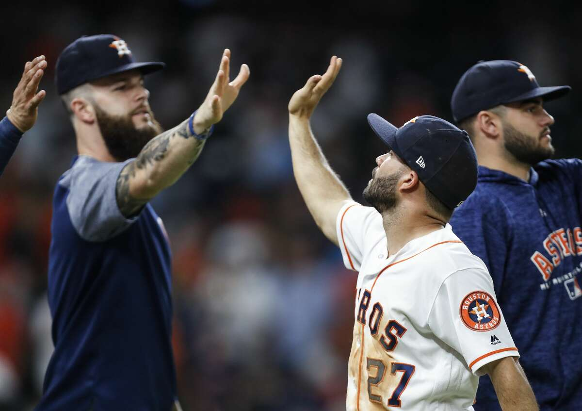 Houston Astros second baseman Jose Altuve (27) high fives pitcher Dallas Keuchel (60) as they celebrate the Astros 5-1 win over the Tampa Bay Rays at Minute Maid Park on Wednesday, June 20, 2018, in Houston. ( Brett Coomer / Houston Chronicle )