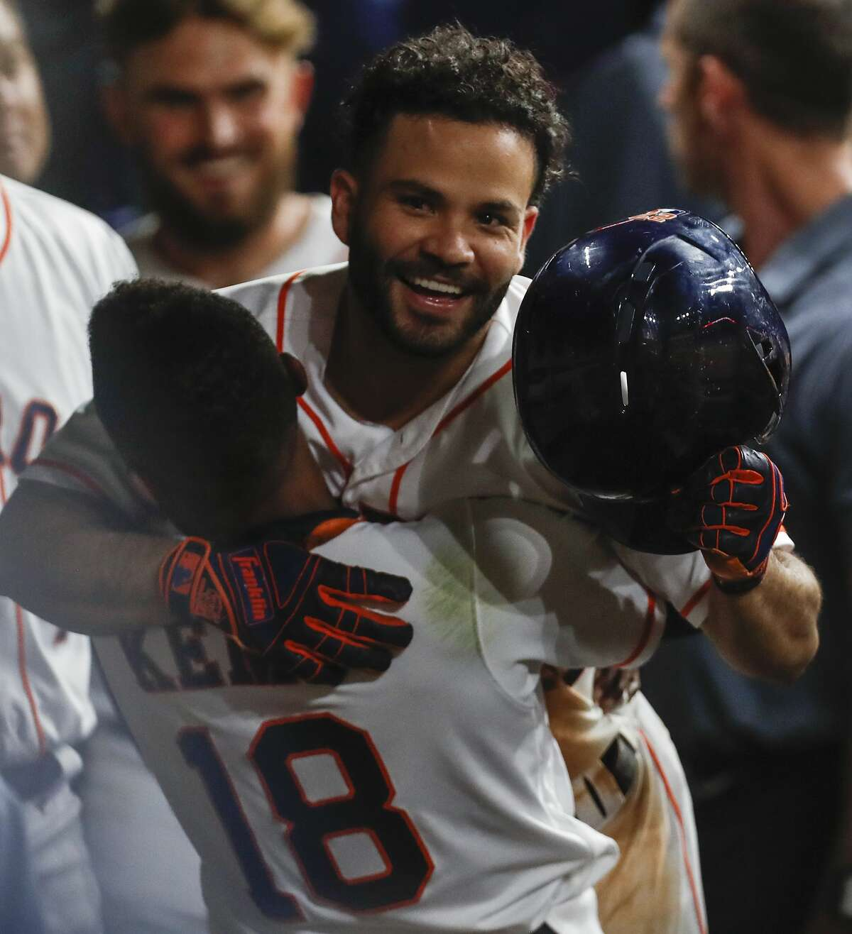 Houston Astros second baseman Jose Altuve and left fielder Tony Kemp (18) embrace as they celebrate Altuve's solo home run off of Tampa Bay Rays starting pitcher Nathan Eovaldi during the sixth inning of a major league baseball game at Minute Maid Park on Wednesday, June 20, 2018, in Houston. It was his second home run of the game. ( Brett Coomer / Houston Chronicle )