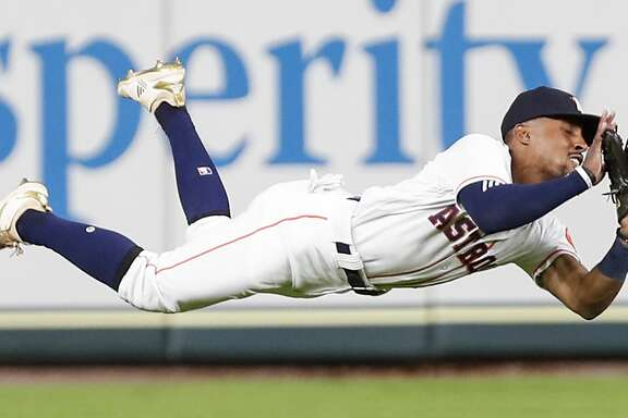 Houston Astros left fielder Tony Kemp (18) makes a diving catch on a fly ball to left by Tampa Bay Rays second baseman Willy Adames to end the first inning of a major league baseball game at Minute Maid Park on Wednesday, June 20, 2018, in Houston. ( Brett Coomer / Houston Chronicle )