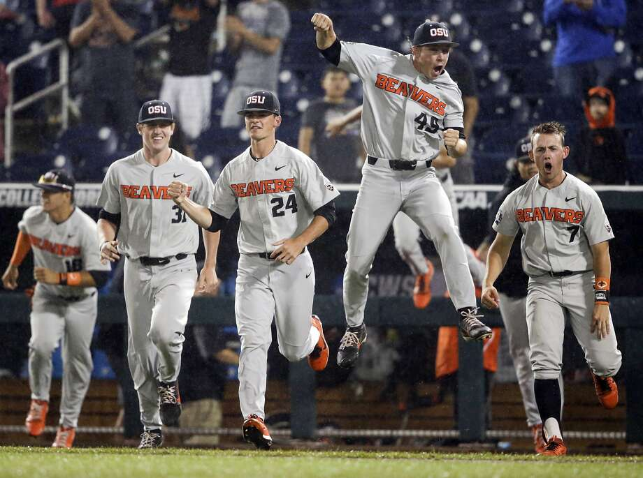 Oregon State players celebrate after the final out against North Carolina in a College World Series elimination game in Omaha, Neb. Photo: Nati Harnik / Associated Press