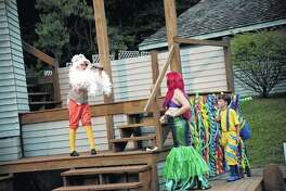 """Scuttle (left), portrayed by Toby Bohanan, uses a """"thingymabob"""" to look at Ariel (Ellen Tuttle) as Flounder (Charlie Holzmacher) watches the exchange during rehearsals for Theatre in the Park's production of """"Disney's The Little Mermaid Jr."""" at Lincoln's New Salem State Historic Site in Petersburg. """
