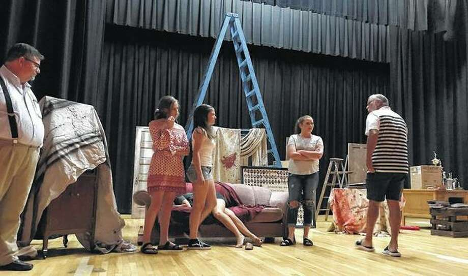 "Members of the cast of ""Hot Rods, Ghosts and Hatchet Heads"" rehearse Monday at the Jacksonville High School auditorium. The play, a celebration of Jacksonville School District 117's 150-year history, opens Friday. Photo:       Photo Provided By Maryjane Million"