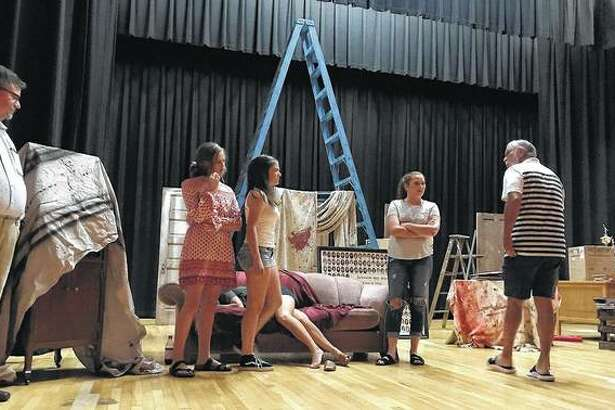 """Members of the cast of """"Hot Rods, Ghosts and Hatchet Heads"""" rehearse Monday at the Jacksonville High School auditorium. The play, a celebration of Jacksonville School District 117's 150-year history, opens Friday."""