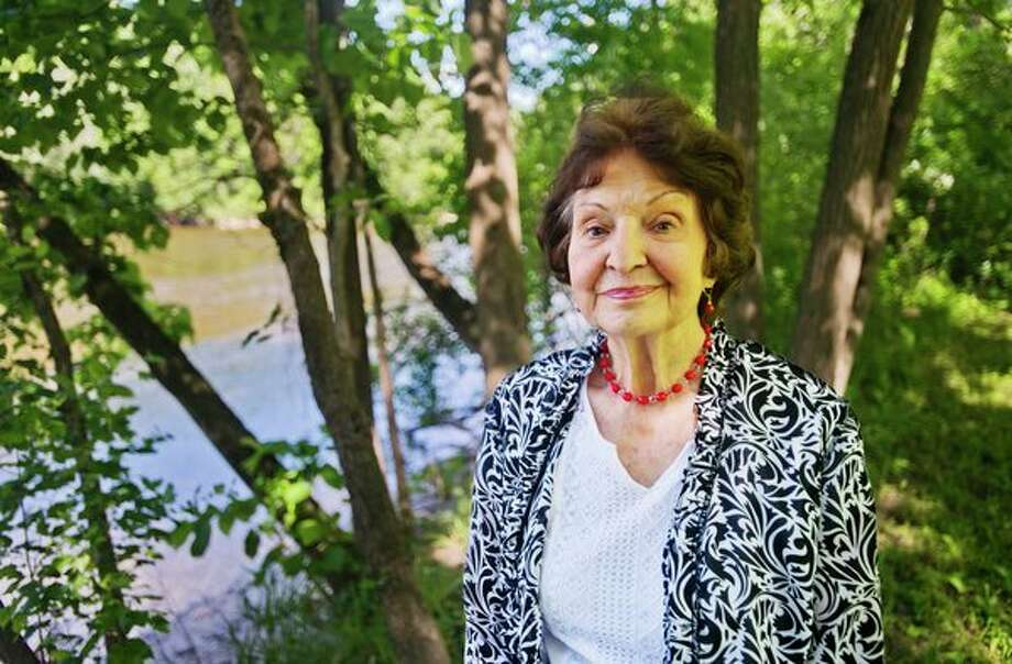 Norma Boeckler poses for a portrait next to the Tittabawassee River in her backyard. (Katy Kildee/kkildee@mdn.net)