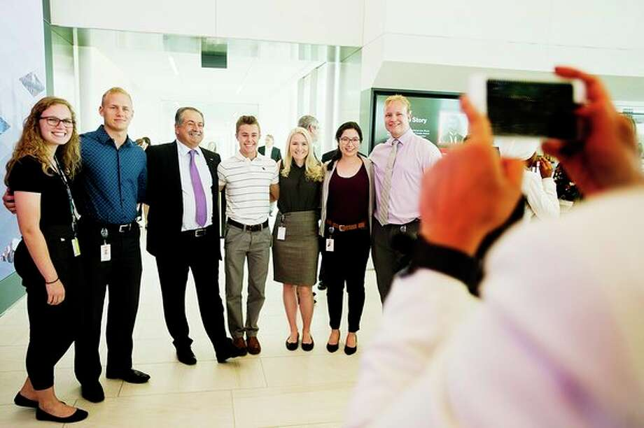 Dow CEO Andrew Liveris poses with Dow employees during an event allowing them to check out the new Andrew N. Liveris Visitors and Heritage Center on Monday,  at the company's Midland corporate headquarters. (Katy Kildee/kkildee@mdn.net)