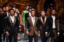 MILAN, ITALY - JUNE 16:  Mariano Di Vaio, Cameron Dallas and Kailand Wonder walk the runway at the Dolce & Gabbana show during Milan Men's Fashion Week Spring/Summer 2019 on June 16, 2018 in Milan, Italy.  (Photo by Jacopo Raule/Getty Images)