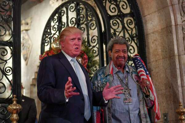 President-elect Donald Trump and fight promoter Don King address the media in December 2016 in Palm Beach, Fla.
